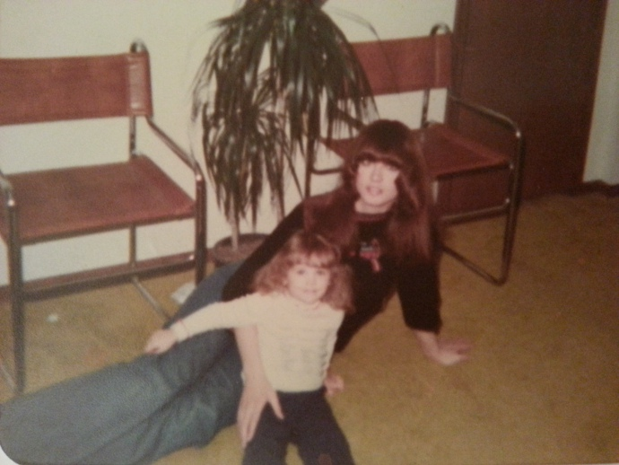 My mom and I and the potted palm. I am about three years old in this picture, so the plant was in its full glory in 1979. Incidentally, that was my favorite shirt of my mom's. It had very groovy embroidered 1970s birds on the front. I thought she looked beautiful in it.