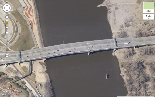 It's a little different crossing the river on this solid mass of multi-lane concrete that I'm used to traveling over.