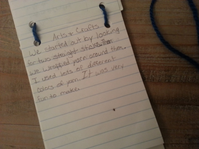 """My handmade """"Elm"""" combination identification badge and activity journal still has a 25 year old bug smashed into the Arts and Crafts page."""